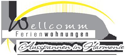 Wellcomm Ferienwohnungen Logo